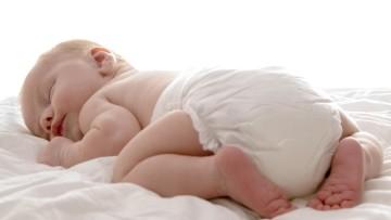Поза сна на животике у младенцев